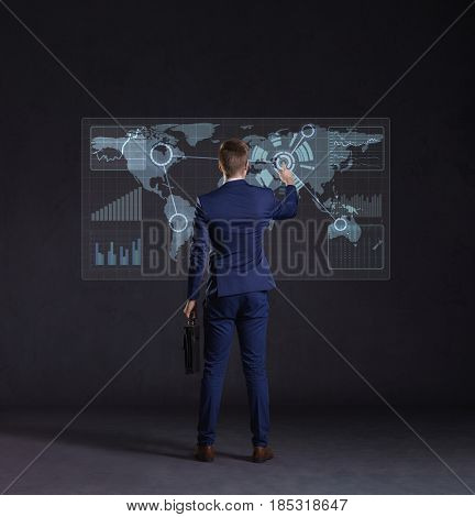 Businessman standing with briefcase. World map background. Business, globalization, concept.