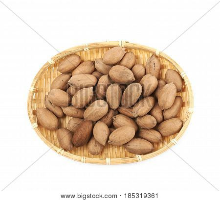 Wicker basket full of pecan nuts isolated over the white background