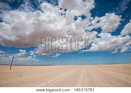 Vibrant Image Of Desert Road And Blue Cloudy Sky