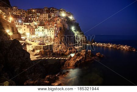 picturesque village of Manarola at night, on the Cinque Terre coast of Italy