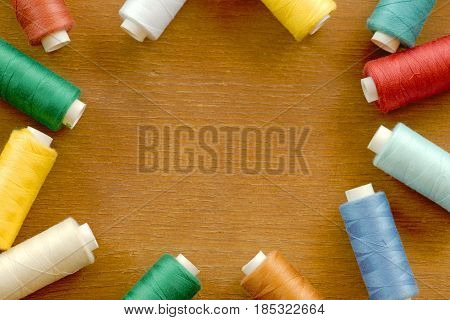 Frame of sewing thread spools of different colors