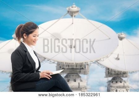 businesswoman with 3d rendering satellite dish background