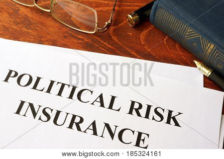 Political Risk Insurance policy on a table.