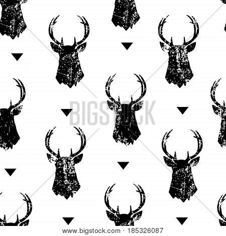 Seamless pattern with the head of a deer and triangles. Ornament for textile and wrapping. Vector.