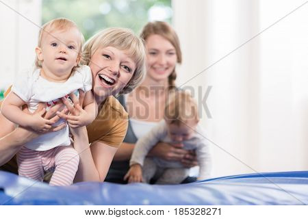 Young moms and their little children in mother and child course