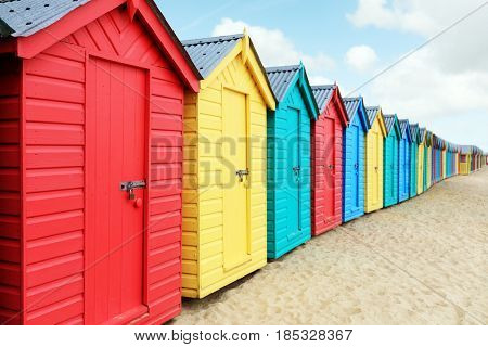 Beach huts or colorful bathing boxes on the beach