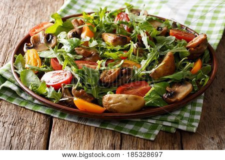 Fresh Salad With Fried Mushrooms, Rucola And Tomatoes Close-up. Horizontal