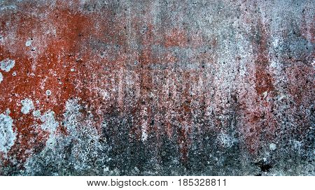 abstract background and texture of rust brown red mixed with white and gray spots.