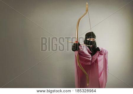 Beautiful Asian Muslim Woman With Veil Want To Shoot An Arrow