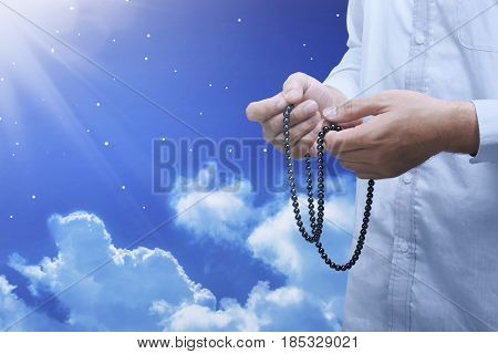 Hands Of Muslim Person With Prayer Beads In Hand Praying