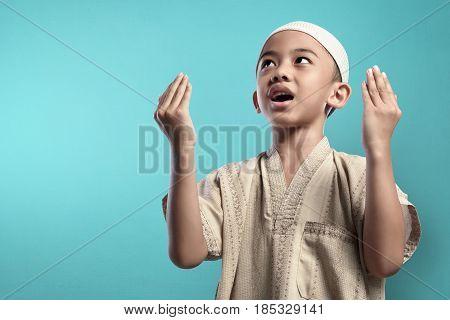Little Asian Muslim Kid Raising Hand And Praying To God