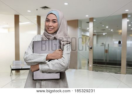 Young Asian Muslim Woman Working With Laptop