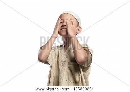 Little Asian Muslim Kid With White Cap Praying