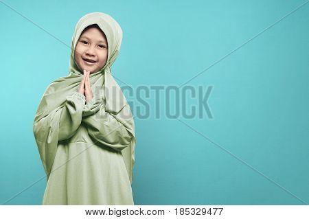 Smiling Asian Muslim Child With Hijab Dress Praying