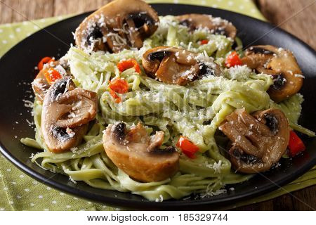 Spinach Noodles With Mushrooms And Parmesan Cheese Close-up. Horizontal