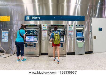 Singapore - July 10: Unidentified People Buy Tickets At The Mass Rapid Transit (mrt) On July 10, 201