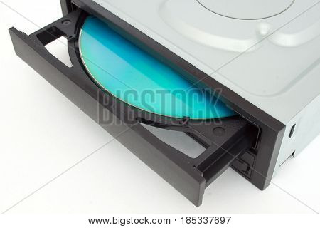 Open-ended CD - DVD drive with a black cap and disk inside. Isolated object.