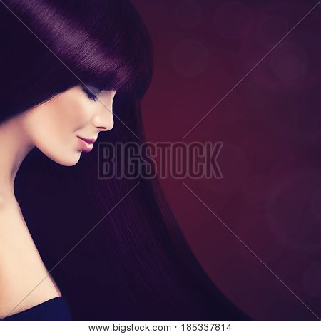 Beautiful Woman with Long Healthy Purple Hair on Blured Backgroung. Hair Coloring and Beauty Salon Background with Copy Space for Text
