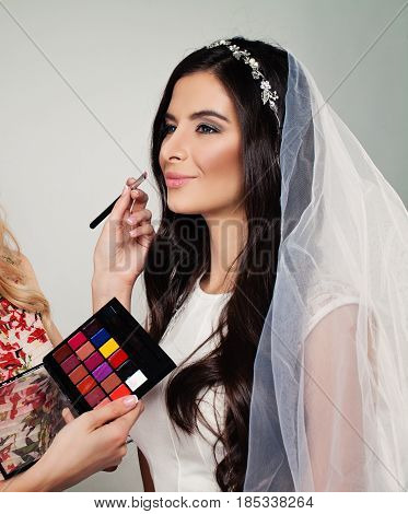 Bridal Makeup. Perfect Bride with Wedding Make up Long Curly Hair and White Veil
