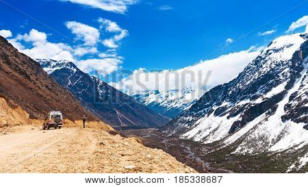 Beautiful Landscape Of Chopta Valley With Snow Covered Beautiful Mountain Peaks Against The Blue Sky