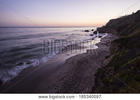 Malibu California pacific ocean dusk at El Matador State Beach.