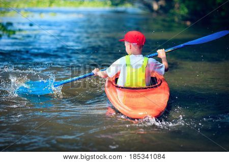 man paddling in kayak is on a river kayaking