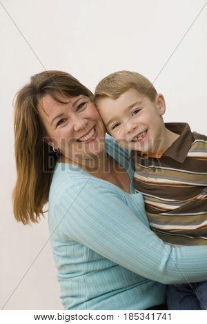 Caucasian mother hugging son