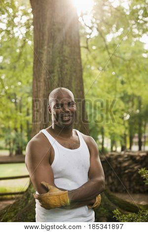African American man in gloves standing outdoors