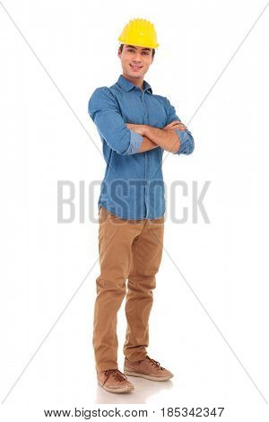 full body picture of a young construction engineer with arms folded standing on white background