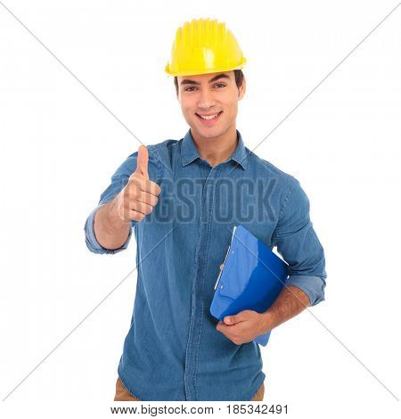 smiling young construcion engineer making the ok thumbs up hand sign on white background