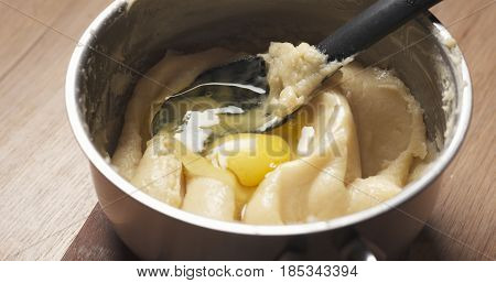 preparing choux dough in saucepan, 4k photo