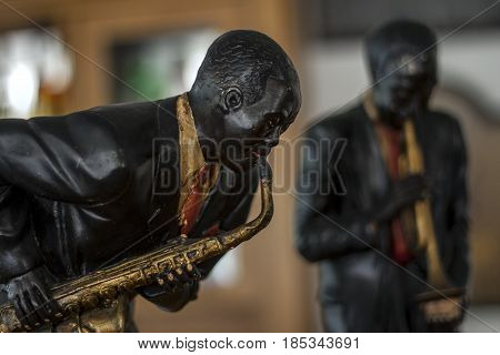 Wooden sculpure.Portrait of a jazz musician playing the saxophone.