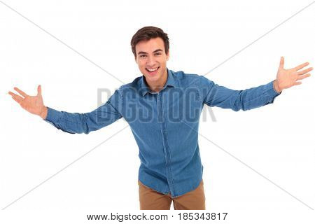 excited young casual man welcoming you on white background