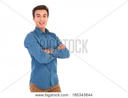young casual man with hands folded posing in studio on white background with copyspce