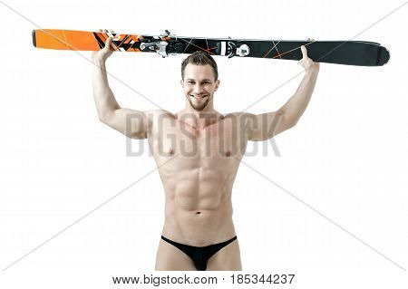 Isolation of a ski jumper holds skis on his head