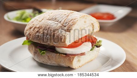 Fly out reveal ciabatta sandwich with speck, mazzarella and vegetables, 4k photo
