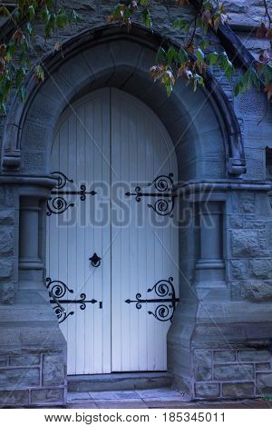 Ghostly old church doors - moonlight at midnight