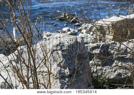 The stone on the shore of the current river