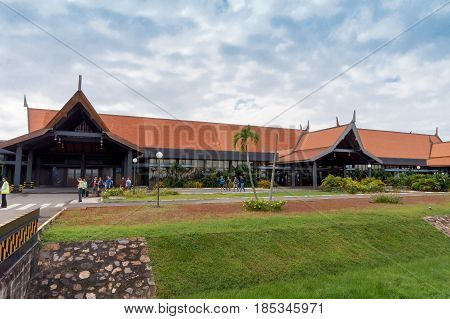 Siem Reap Cambodia - October 29 2016: Siem Reap International Airport looking from the apron while passengers are walking to board the airplane.