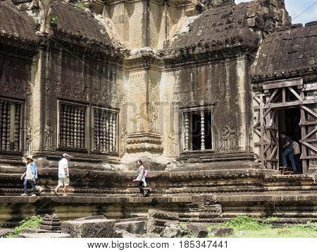 Siem Reap Cambodia - October 30 2016: the 12th century temple building in Angkor Wat UNESCO World Heritage site in Cambodia visited by tourist.