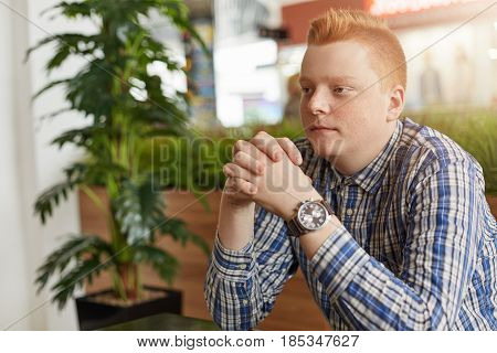 A Sideways Portrait Of Handsome Young Freckled Man With Stylish Red Hair Dressed In Checked Shirt Si