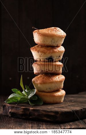 Blueberry Muffins With Fresh Berries On Old Wooden Background