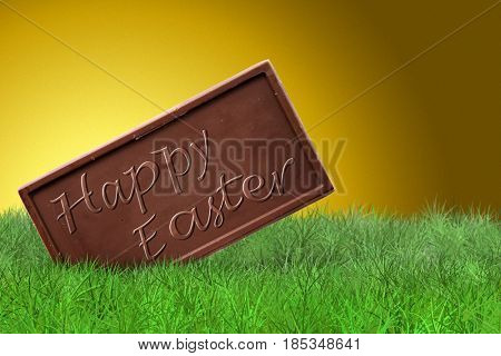 Happy Easter text on chocolate bar on golden background