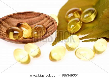 Fish Oil Omega 3 Gel Capsules In Spoon With Leaf