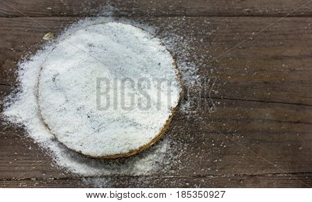 Common salt in a straw round bowl. top view. copy spase