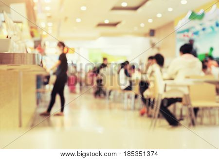 Defocused or blurred photo of food court use for background.