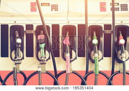 Gasoline nozzle in petrol station service vintage color tone.