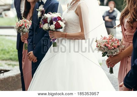 Stylish Groom And Bride With Rustic Bouquet, Bridesmaids With Pink Roses And Groomsmen, Posing In Mo