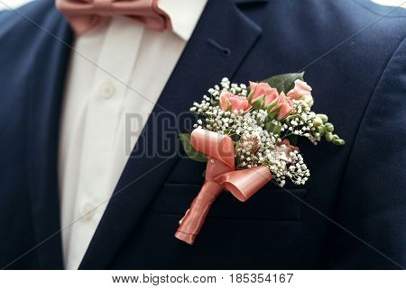 Stylish Groom Or Groomsmen In Suit With Pink Roses Boutonniere And Bow Tie Posing, Getting Ready In