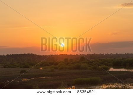 Red Sun At Sunset On The Horizon In The Spring